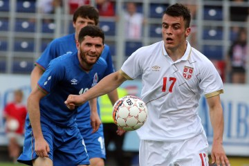 Serbia's Filip Kostic, right, challenges for the ball with Azerbaijan's Javid Huseynov , left, during a friendly soccer match between Serbia and Azerbaijan in St. Poelten, Austria, June 7, 2015. (AP Photo/Ronald Zak)