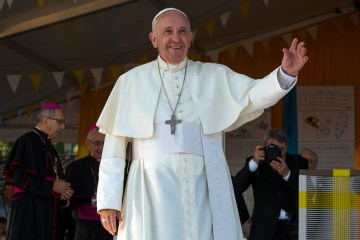 Pope Francis waves as he celebrates Mass in Asuncion, Paraguay, July 12, 2015. (L'Osservatore Romano/Pool Photo via AP)
