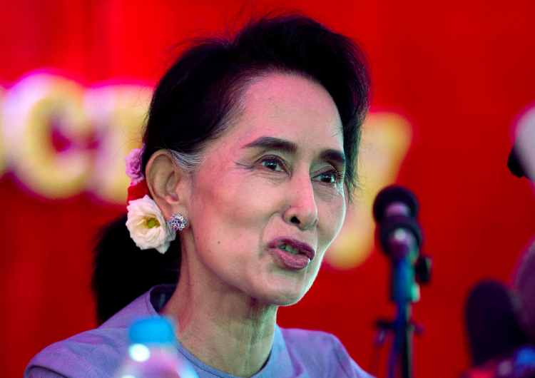 "Myanmar's opposition leader Aung San Suu Kyi has said she'll be ""above president"" if her party wins the election. (AP Photo/Mark Baker)"