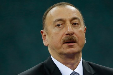 Azerbaijani President Ilham Aliyev attends a medal ceremony at a wrestling event at the 2015 European Games in Baku, Azerbaijan, Saturday, June 13, 2015. (AP Photo/Dmitry Lovetsky)