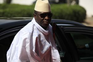 Gambia's  President Yahya Jammeh arrives for a summit to address a seminar on security during an event marking the centenary of the unification of Nigeria's north and south in Abuja, Nigeria, Feb. 27, 2014. (AP Photo/Sunday Alamba,)