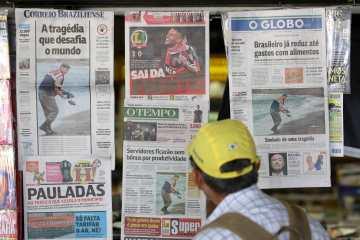 Brazilian newspapers displayed Sep. 3, 2015.  (AP Photo/Eraldo Peres)