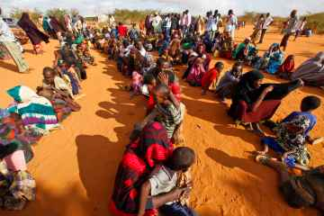 Newly arrived refugees who fled famine-hit Somalia waiting in line at a reception at Ifo camp, one of three camps that make up sprawling Dadaab refugee camp in Dadaab, northeastern Kenya in 2011. (EPA/Dai Kurokawa)
