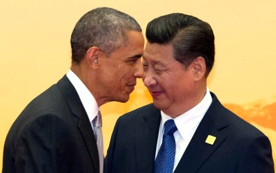 U.S. President Barack Obama walks past Chinese President Xi Jinping during a welcome ceremony for the Asia-Pacific Economic Cooperation (APEC) summit at the International Convention Center in Yanqi Lake, Beijing, China, Nov. 11, 2014. (AP Photo/Ng Han Guan)