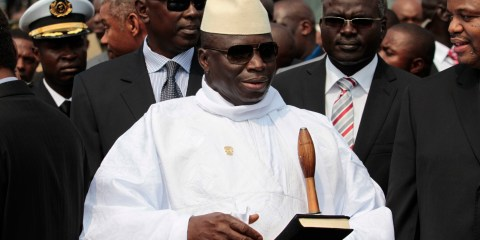 Gambian President Yahya Jammeh stands outside the Sipopo Conference Center in Malabo, Equatorial Guinea, ahead of the opening session of the 17th African Union Summit in June 2011.  (AP Photo/Rebecca Blackwell)