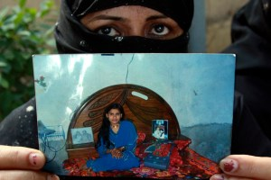 A Pakistani mother holds a picture of her daughter showing Tasleem Solangi, killed in a rural area of Pakistan's southern province of Sindh, in Karachi, Pakistan. (AP Photo/Shakil Adil)