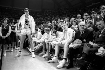 Clarkson's photo of Coach Adolph Rupp's University of Kentucky all-white men's basketball team after it lost the 1966 NCAA championship to Texas Western, which was the first major collegiate team to start five black players in the NCAA final.  The picture was a symbol of the changes taking place in the U.S. (Rich Clarkson)