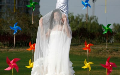 A model present a wedding gown during  a show by the M&Y Wedding Design in Beijing, April 23, 2011. (AP Photo)