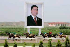 A huge portrait Turkmen President Gurbanguly Berdymukhammedov stands beside the horse race track in Ashgabat, Turkmenistan in May 2007. (EPA/Mikhail Klimentyev)