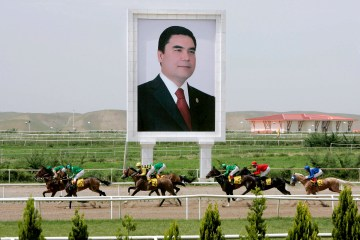 A huge portrait Turkmen President Gurbanguly Berdymukhammedov stands beside the horse race track in Ashgabat, Turkmenistan in May 2007. (EPA/Mikhail Klimentyev)