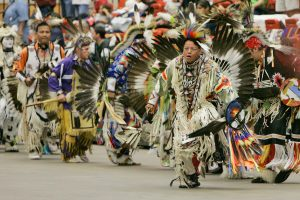 Gabriel Cleveland, a Ho-Chunk tribe member from Wisconsin Dells, Wis., participates in the Grand Entry of the Red Earth Festival in Oklahoma City, June 1, 2007. (AP Photo)