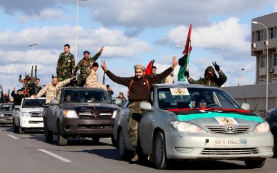 Libyan militias from towns throughout the country's west parade through Tripoli, Libya, Feb. 14, 2012. (AP Photo/Abdel Magid Al Fergany, File)