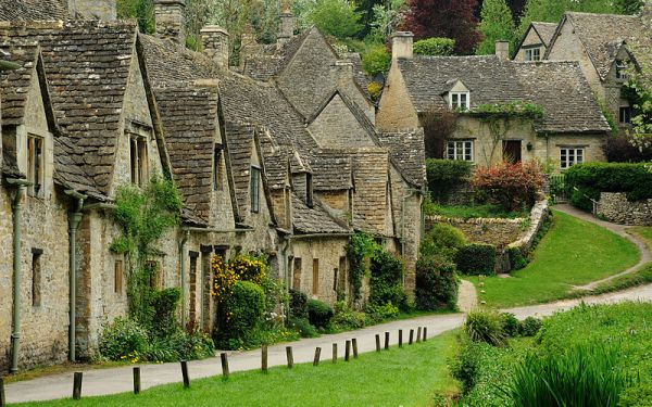 Arlington Row, Bibury, UK was built in 1380 as a monastic wool store. The buildings were converted into weaver cottages in the 17th century. Photo by Saffron Blaze.