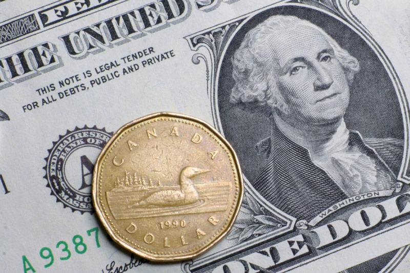 Greenback trims losses but remains under pressure vs. loonie