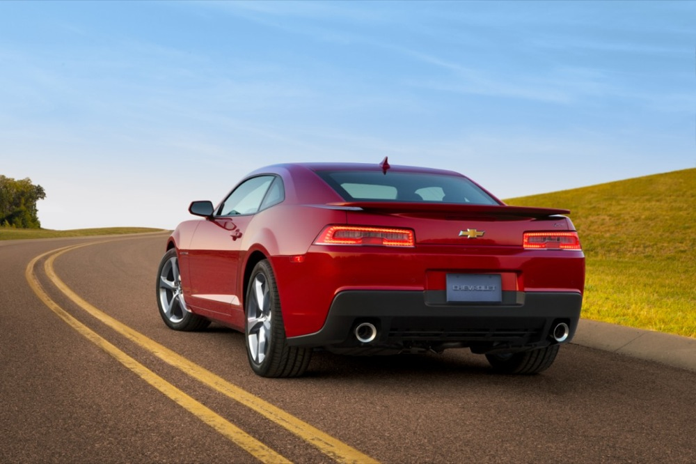 The 2014 Camaro And A Photo Of Its Rear Lights In The Dark GM