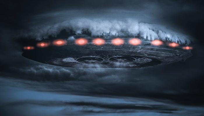 alien_spaceship_breaking_through_the_clouds_over_a_desert_highway