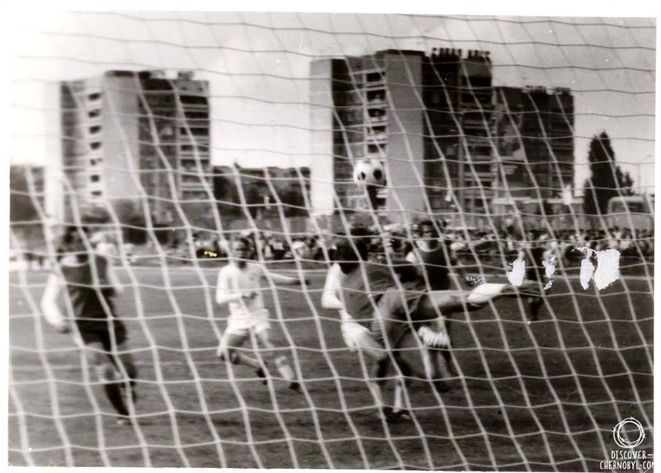 A match is going on in the older football stadium of Pripyat between Stroitel Pripyat and Selmash Belya Tserkov, 1985. [Source: discover-chernobyl.com]