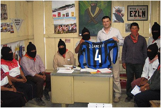 Figure 1: Zapatista rebels unveiling Zanetti's #4 shirt to show his support. Source: El Paso