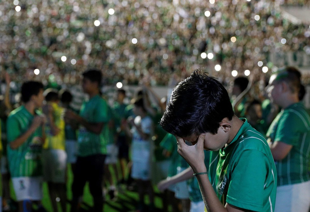 Fans of Chapecoense pay tribute to the players of the Brazilian football team on Wednesday. [Source: Getty Image]