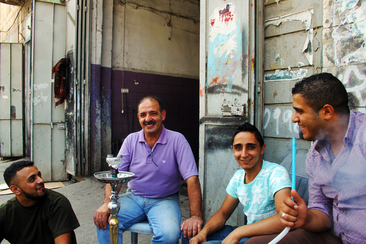 Halil Amar (the guy with big smile) infront of his car service in Nablus.