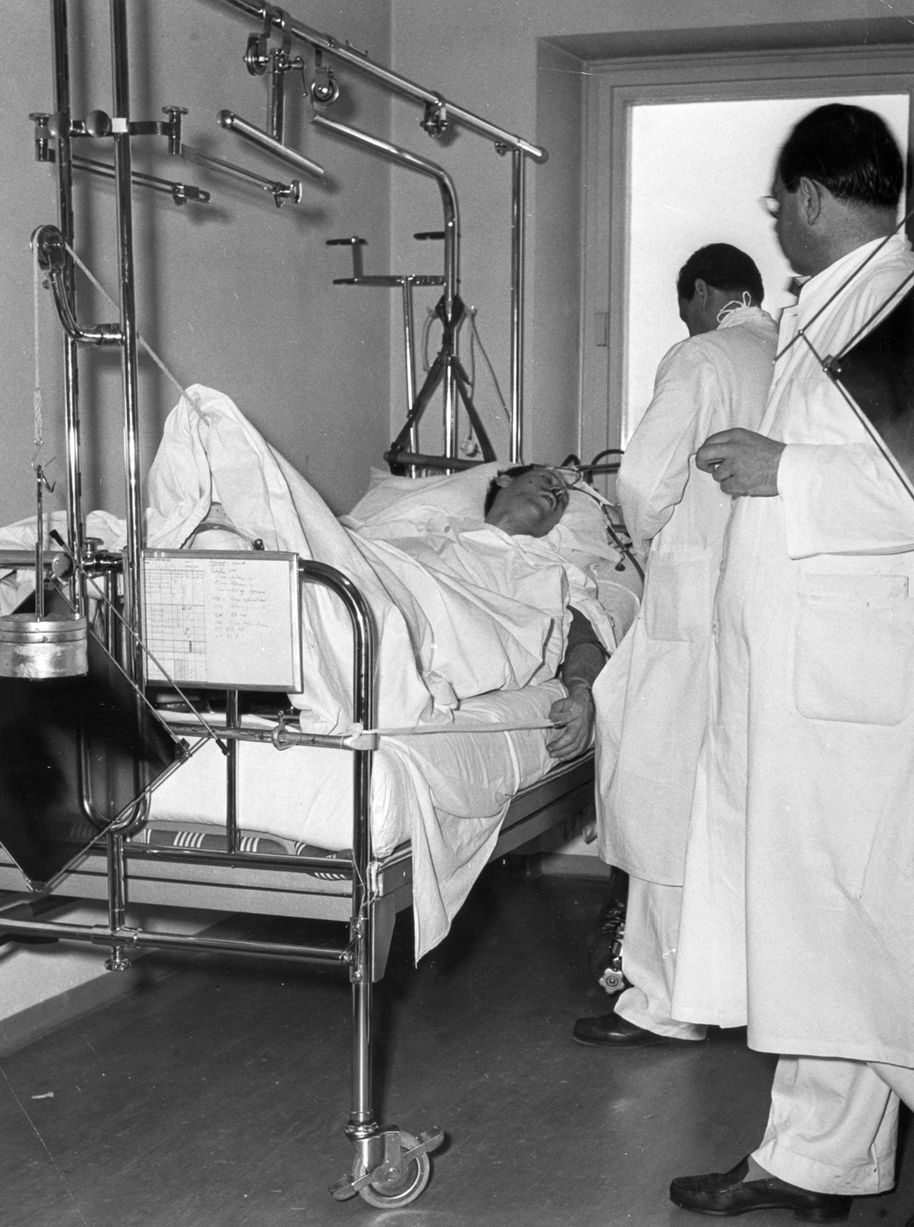 Captain Ken Rayment lies injured in hospital in Munich. Captain Rayment was co-pilot on the the ill-fated British airliner carrying the Manchester United football team