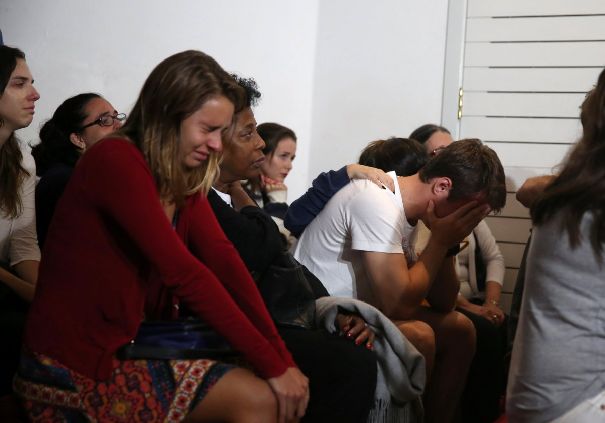 Relatives of Brazilian journalist Guilherme Marques, who died in the plane accident, mourn during a mass in Rio de Janeiro, Brazil. REUTERS/Pilar Olivares
