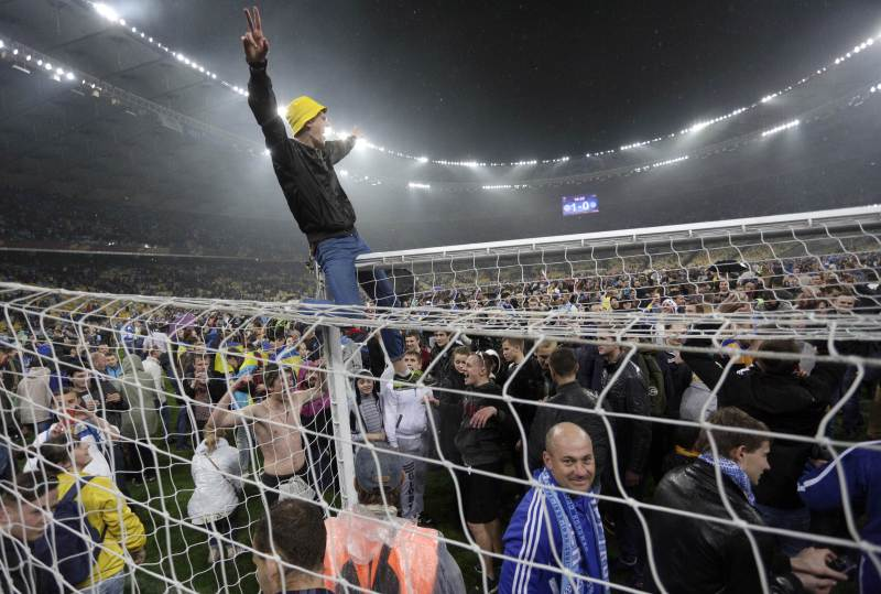 Jubilant fans invaded the pitch in celebration.