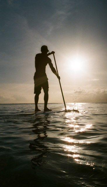 Tiki Man SUP sunset vertical