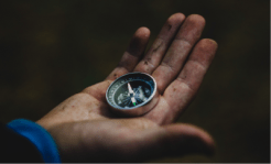 hand-holding-compass