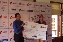 Sharmila Nicollet collects the winner's cheque at Jaypee Greens