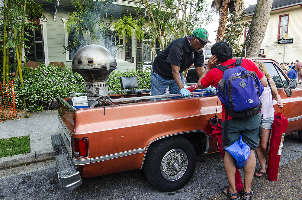 April 22, 2016 - New Orleans, LA: Attendants of the New Orleans Jazz and Heritage Festival spill out of every exit into growing street parties on each of the nearest streets following the fest. Many residents in the area pull out all the stops including this man who grilled and visited with festival goers from the bed of his truck. (Photo by Katie Sikora)