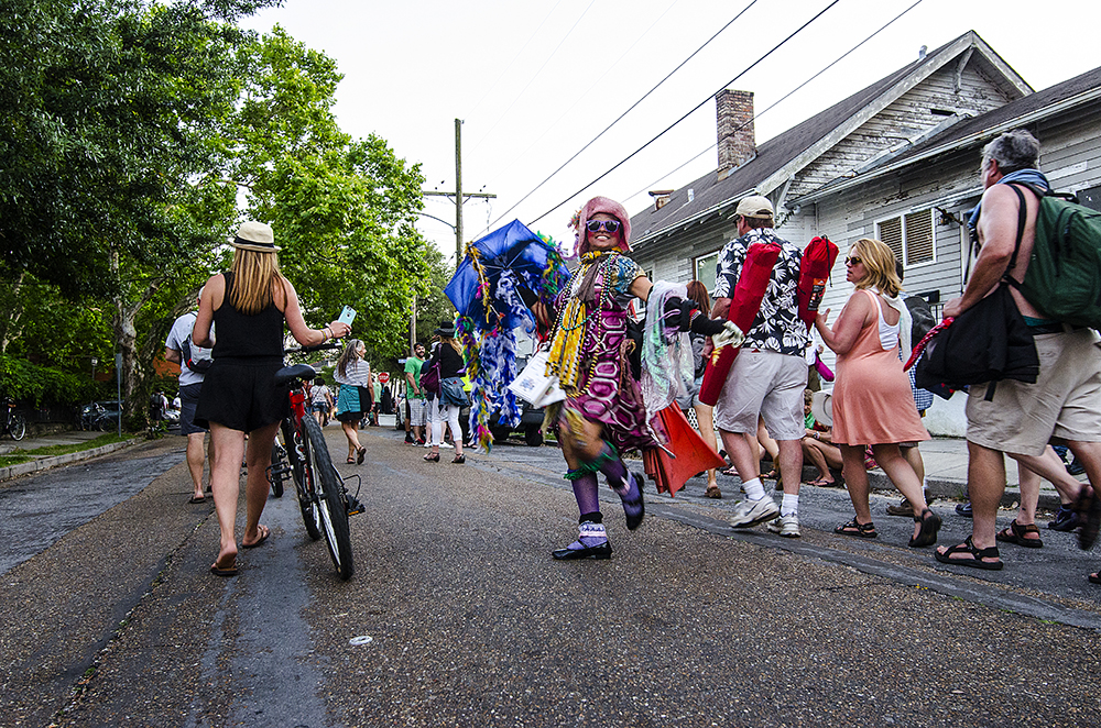 April 22, 2016 - New Orleans, LA: The streets surrounding the Fairgrounds become packed with artists, musicians, and fans following the New Orleans Jazz and Heritage Festival, creating impromptu street parties. One of those artists is street performer Jennifer Jones who spreads her spirituality and message of peace at parades, festivals, and jazz funerals througohut the city. (Photo by Katie Sikora)