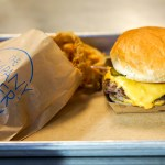 Company Burger uses a premium, all natural beef for their patties, their own house-made toasted buns, and you won't find wilted (or any) lettuce or tomatoes as garnishes on their griddled hamburgers. (Photo: Paul Broussard)