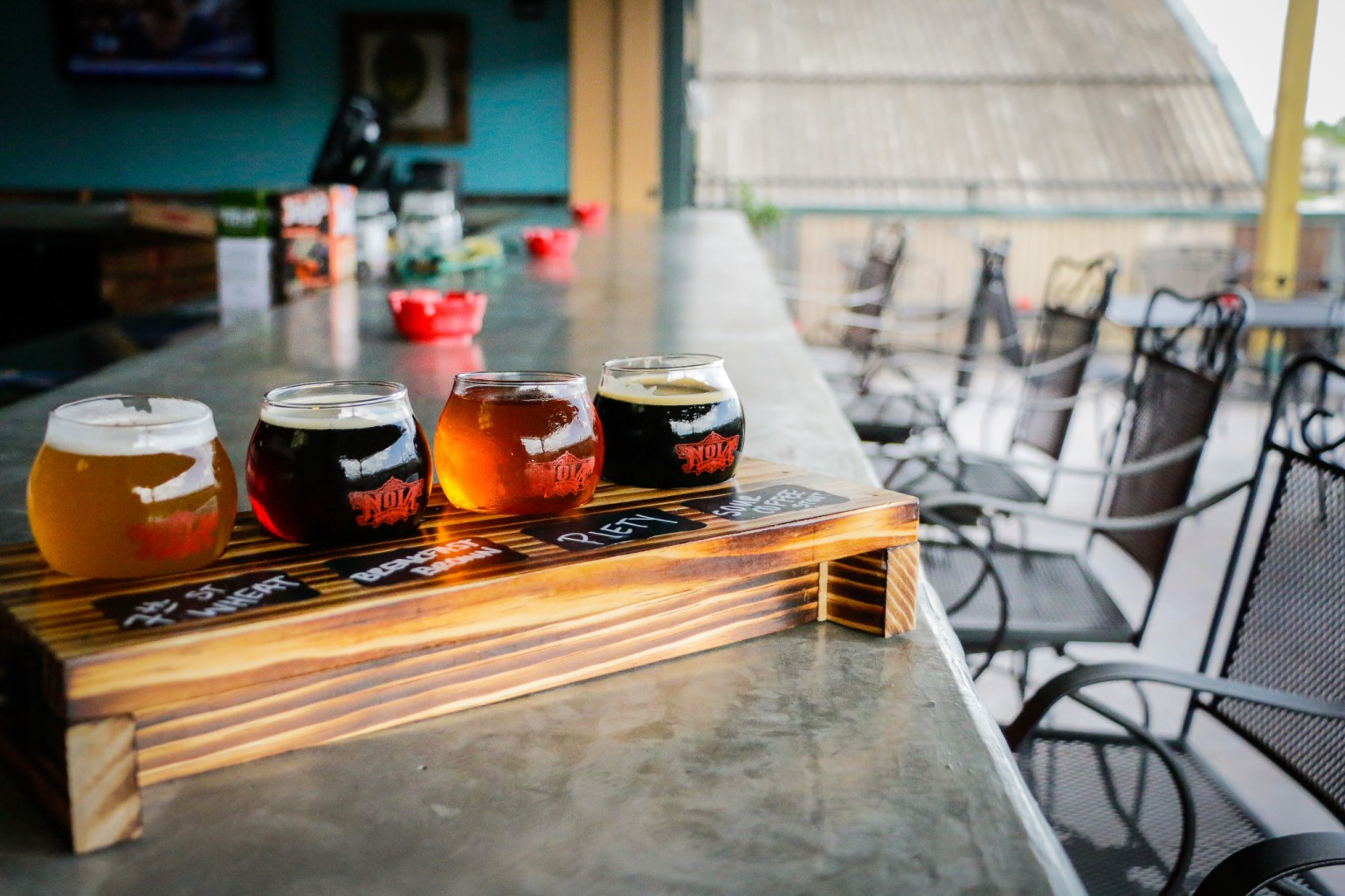 A beer flight on the balcony at NOLA Brewing. (Photo: Rebecca Ratliff)