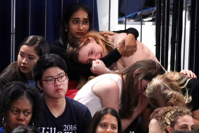 NEW YORK, NY - NOVEMBER 08: A group of women react as voting results come in at Democratic presidential nominee former Secretary of State Hillary Clinton's election night event at the Jacob K. Javits Convention Center November 8, 2016 in New York City. Clinton is running against Republican nominee, Donald J. Trump to be the 45th President of the United States. (Photo by Drew Angerer/Getty Images) Getty Images North America 681261599 621811656