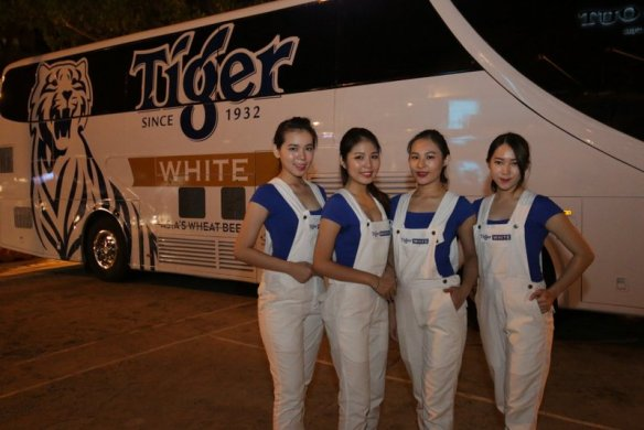 Tiger White brand ambassadors strike a pose before the Tiger White bus