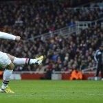Podolski celebrates with Arsenal away fans after derby triumph