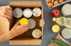top-view-of-hand-preparing-food-donations