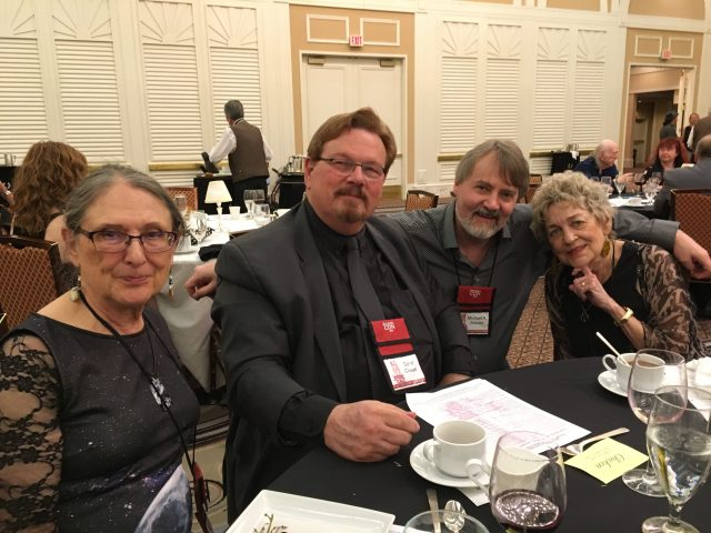 Visiting the poet's table:  Mary Turzillo, David Cowen, Arnzen, and guest of honor Marge Simon.