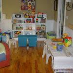 We categorized toys, helped pick bookcases, bins and a craft table to transform this space