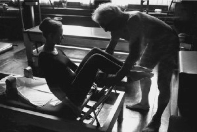 PLATE 26A student on reformer