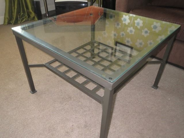 Glass and Black Metal Coffee Table