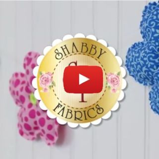 Here's a fun way to decorate a girl's room, craft room, or any room.This DIY 3D Flower Garland video tutorial by Shabby Fabrics shows you how. -Sewtorial