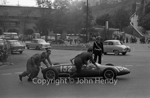 Geki is wheeled to the pits at Monaco in his Lotus 22, c. 1962. (John Hendy)