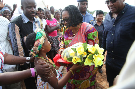 First Lady Lordina Mahama receives a bouquet on arrival at Bamionko for the inauguration of the Gwiraman Community SHS