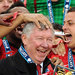 Manchester United players celebrate their Premier League championship with their retiring manager Alex Ferguson.