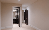 Interior design with black doors and white walls and white ...
