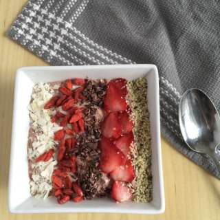 This vegan Strawberry Flax Smoothie Bowl is a sweet treat that just happens to be packed with healthy omega 3 fats.  Have for breakfast or dessert.