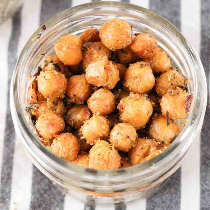 Cheesy Herb Roasted Chickpeas are a delicious vegan snack that are perfect for lunch boxes and travel!