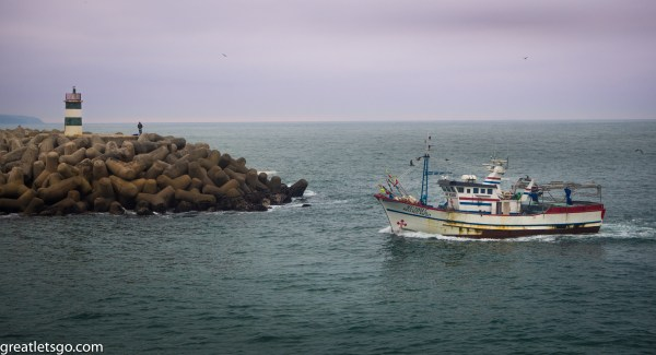 Fishing boat entering the harbour.